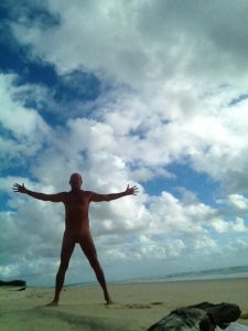 Paul on a one man Rainbow Beach Qld Australia Standing with arms outstretched in awe of the beauty that surrounds me.