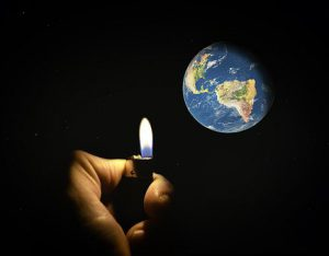A man strikes a lighter and we can see the earth, our home