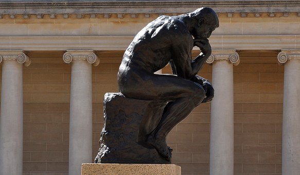 a statue of ' the thinker' in deep thought