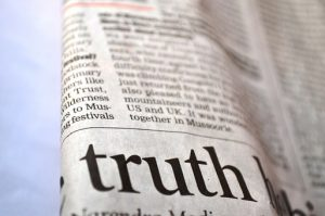 a newspaper headlines an article on truth