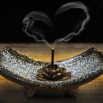 incense burning with the smoke taking the shape of a love heart
