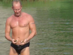 Photo of Paul in speedos after swim with a well defined body at 55