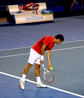 Roger on blackhead bang, rusty coloured top,white shorts socks ans shoes, serves for the match, Again!