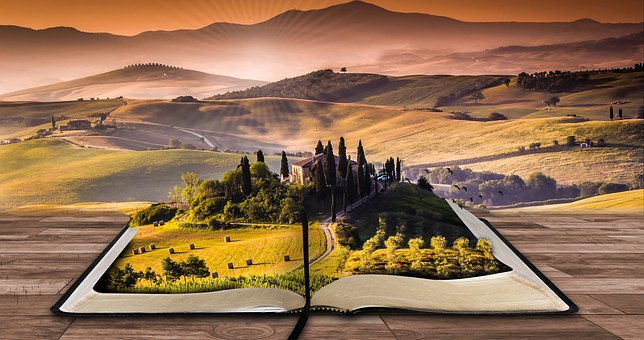 Fantasy photo of a beautiful misty valley, A book is open inviting you to write your own story