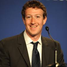 Mark Zuckerberg speaking to audience and smiling