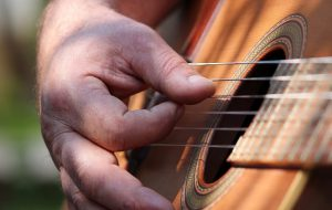 A man strumming a guitar