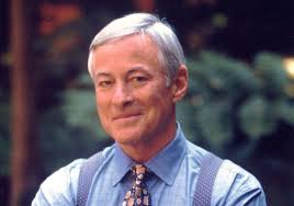 Photo of Brian Tracy with a blue shirt and matching tie smiling at the camers