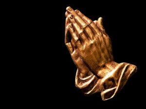 Golden praying hands offer thanks and gratitude