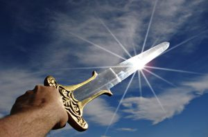 sun reflects off a sword that is raised to the heavens