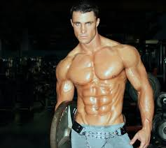 Greg Plitt holing a weight no shit only jeans amazing 6 pack
