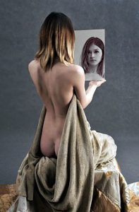 semi naked woman-exams how she looks in a mirror