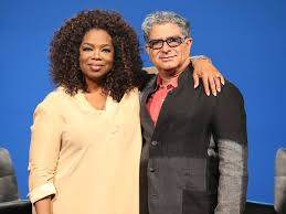 Deepak And Oprah Winfrey Posing For Photo Arms Around Each Other