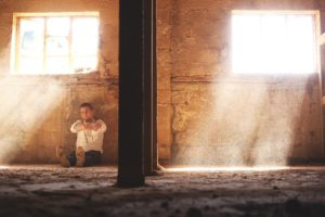 man sitting alone in an old warehouse-Pondering!