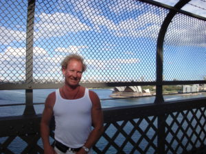 Photo of Me, Paul standing on the bridge with Sydney Opera House In background on a beautiful day in Sydney